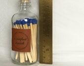 NEW SIZE, LARGER bottle, longer matches, leather label