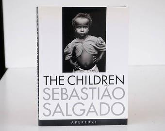 ART HISTORY Sebastiao Salgado The Children Aperture Mid Century Photography Portraits Refugees Charity Student Humanity Eames Coffee table