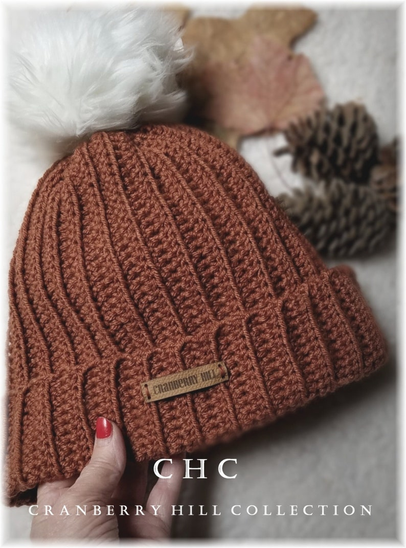 3be61457324 Ribbed Beanie toque with faux fur pom pom. Rusty fall color.