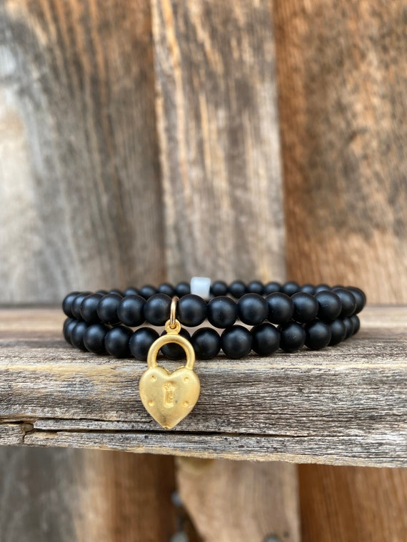 Matte black onyx stretch bracelet stack with gold vermeil heart locket