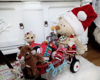 Red Wagon Christmas Bear Arrangement Rudolph Clarice, Red Metal Truck, Decorated Christmas Tree, Plush Santa, Gift Box Gift Bag, Centerpiece