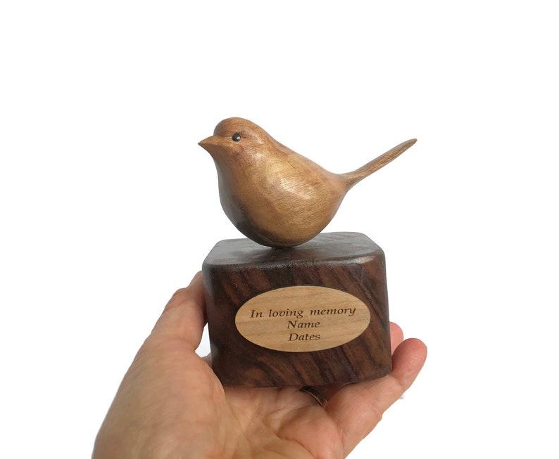 In loving memory bird wood carving