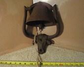 Vintage cast iron cow bell door knocker. Western steer, bull farm dinner bell, door bell.