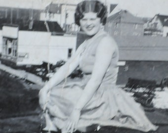 I think she's on the roof, old photo of a cute and pretty flapper woman