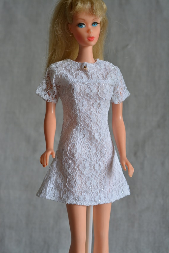 Vintage doll in white lace dress