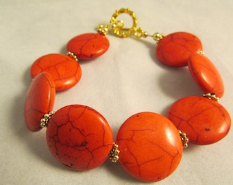 Coral Beads with Gold Plated Spacer Beads and Toggle