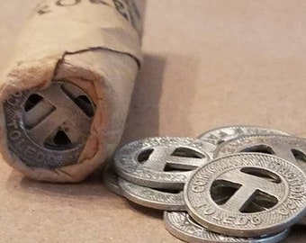 vintage bus transit token roll of 50 coins transportation travel ticket fare jewelry supply metro toledo community traction company