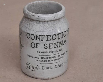 Confection of senna boots cash chemists crazed crock jar crockery pot England transferware apothecary English ironstone advertising jar