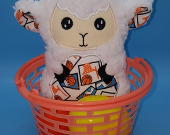 Soft stuffed sheep with various basketball designs featured in tummy accent fabric