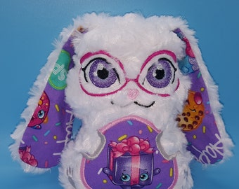 Soft stuffed white rose minky floppy eared bunny w/Shopkins present featured in tummy & ear accent fabric w/big lavender eyes