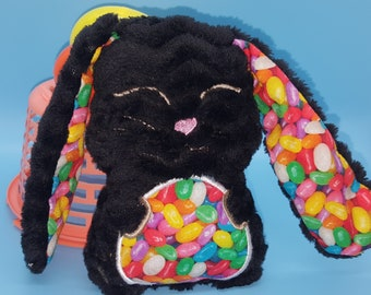 Soft stuffed eyes closed black zig zag minky floppy eared bunny with jelly beans featured in tummy and ear accent fabric