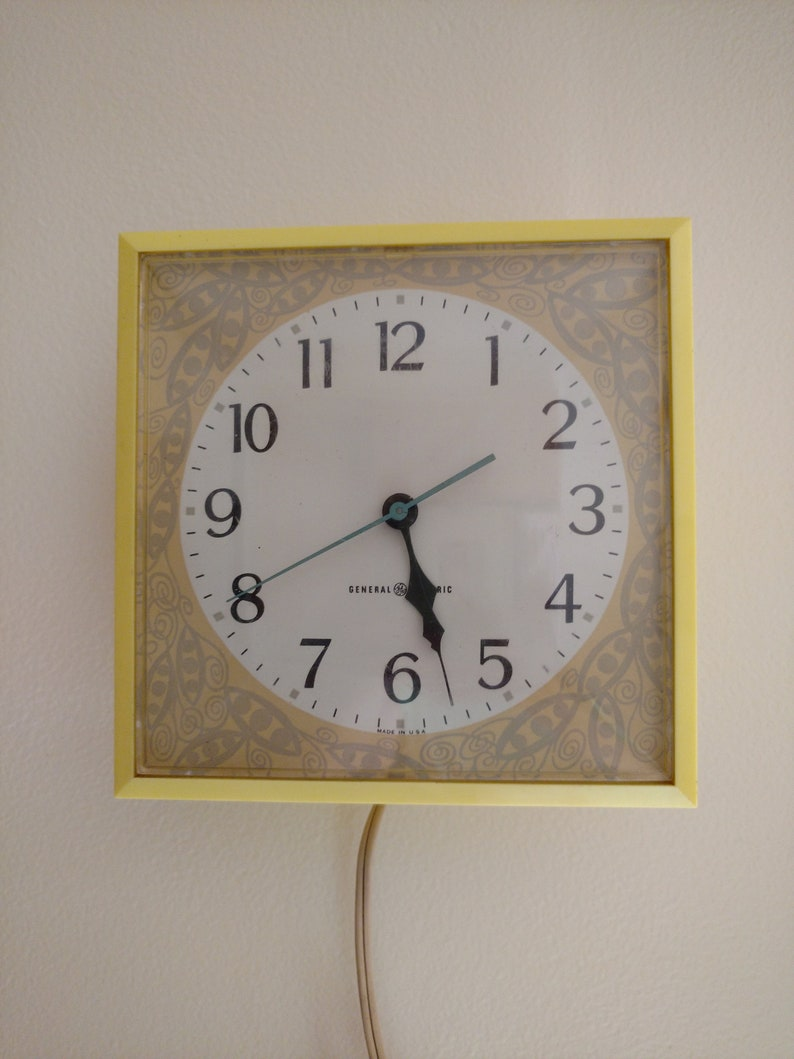 General Electric GE Square Sunny Yellow Electric Wall Clock image 0