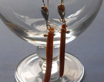 Long golden pearl earrings