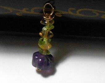 Carved amethyst with peridot and citrine beads in goldfilled