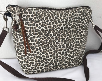 Small Cheetah print crossbody messenger purse,  lightweight & washable tribal black and brown, by Darby Mack,  Made in the USA