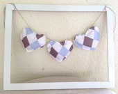 Hanging fabric heart banner, bunting decoration in blue and brown checkered print, perfect for baby and wedding showers, nursery decor
