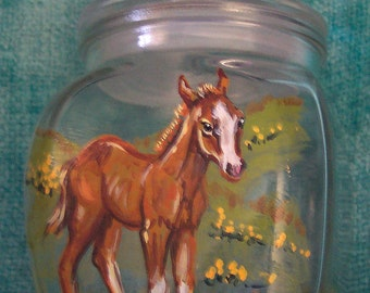 Foal on lidded glass container