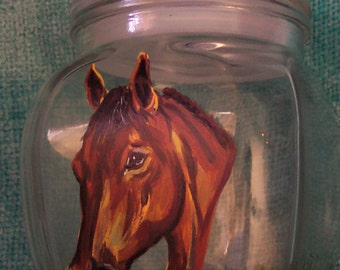Horse head study on lidded glass container