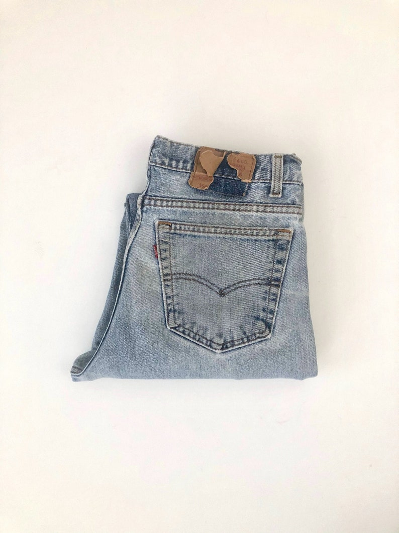 Vintage Men's 80's Levi's 550 Distressed Jeans image 0