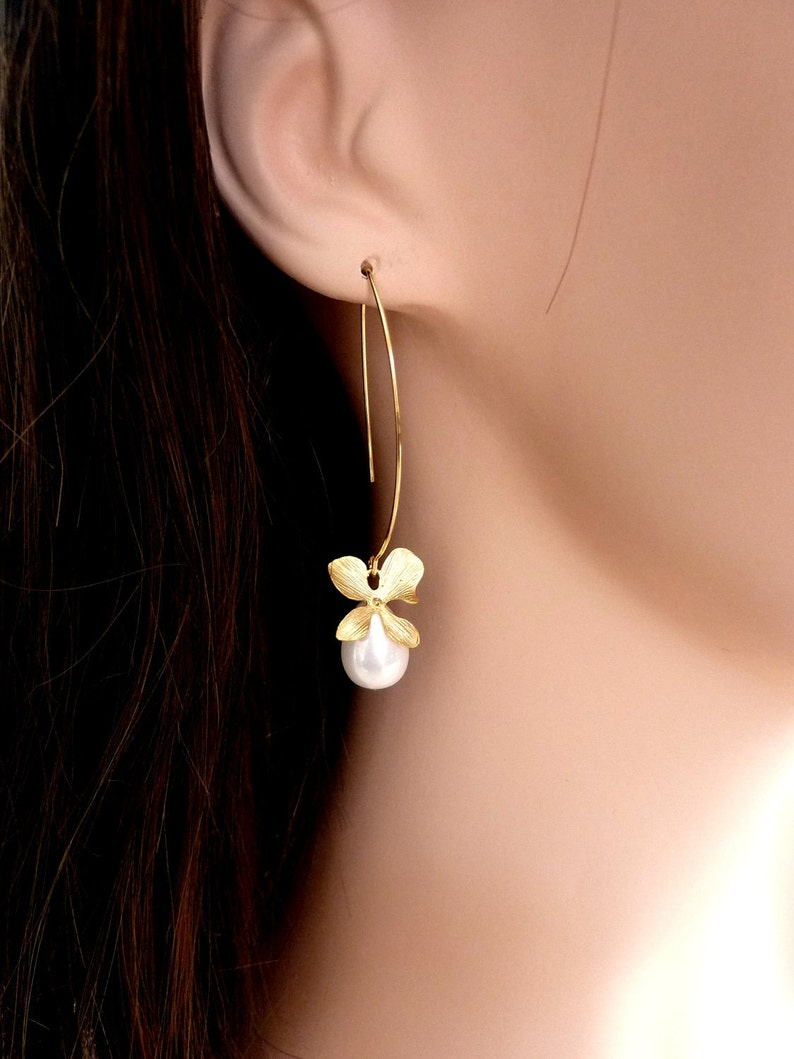 e902df433b90 Lágrima blanca grande gota concha de perla con pendientes de