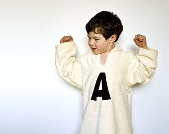 Personalized robe with monogram with hood in organic cotton. Eco friendly bath cape in ivory color. Children gift with monogram.