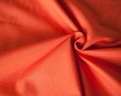 Orange poplin fabric in organic cotton. Organic muslin fabric in mandarin red by the 1/2 meter.