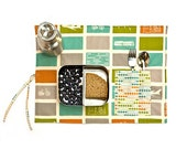 Word traveler placemat for children and adults. Place mat with planes, bikes and trains. Organic placemat for world traveler baby shower.