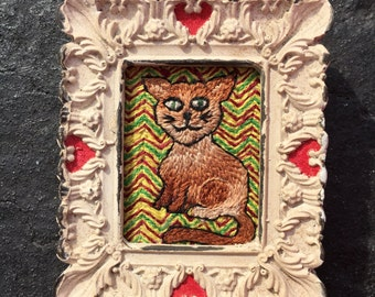 Brown Cat tattoo flash inspired embroidery art in vintage style frame