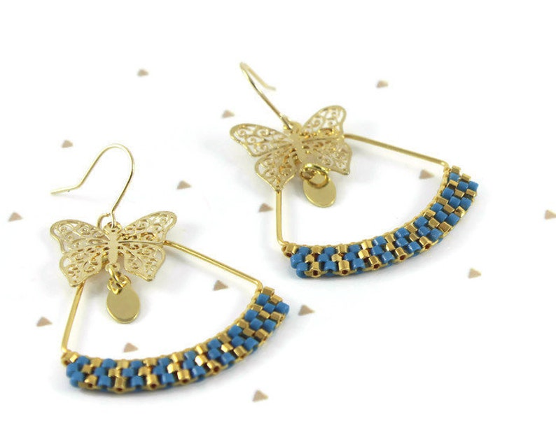 By Nymph\u00e9a blue woven triangles 24 carat gold plated butterfly Gold brass earrings miyuki delicas beads