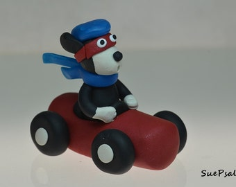 cake topper, figurine, polymer clay, race car driving hound dog, black and white dog, red race car, birthday gift, all occasions gift