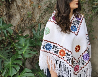 Black and Multi colored Warm Snuggly poncho So many new styles and colors that took almost a year to pull together