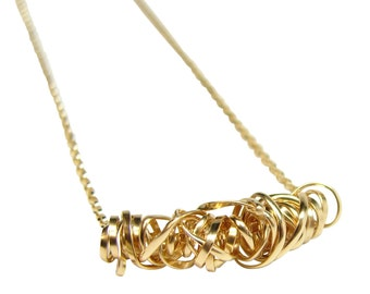 23mm Blackstone Heart pendant with Gold twisted wire wrapped 1060047