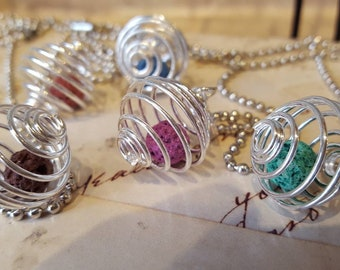 Essential oil diffuser necklace. Silver toned spiral cage locket with lava bead. Choose your own color.