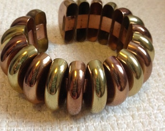 Vintage Mixed Brass Copper Metal Plating, Cuff bracelet.  Wide spring cuff bracelet.  1970s