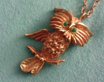 MOD groovy Owl PENDANT necklace.  Gold tone metal and Emerald green eyes.  Vintage 1960 1970.