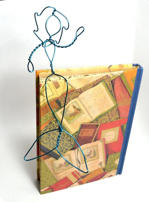 Waving Blue Mermaid Bookshelf Wire Sculpture Sits On