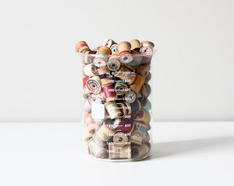 RESERVED lab beaker with wood spools