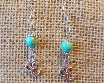 Charming blue turquoise drop earring with silver yoga charm