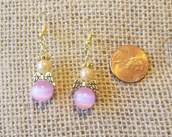 Breast cancer awareness pink. pearl and gold angel earrings