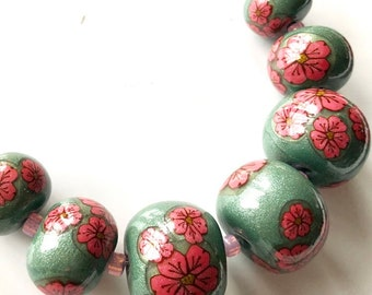 Pink Cherry Blossoms on Metallic Green Polymer Clay Beads, graduated rondelle