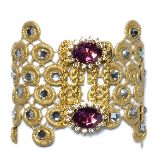 Gold lace bracelet with grey swarovsky crystals and two gorgeous gold plated purple crystal broochs.