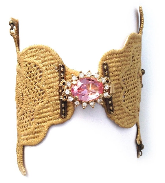 Gold lace bracelet with a 24k gold plated brooch and pink czech crystal.