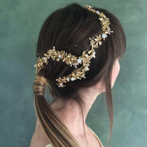 Boho chic headdress in golden flowers. Guada head piece