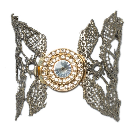 Silver lace bracelet with vintage rhinestone brooch.