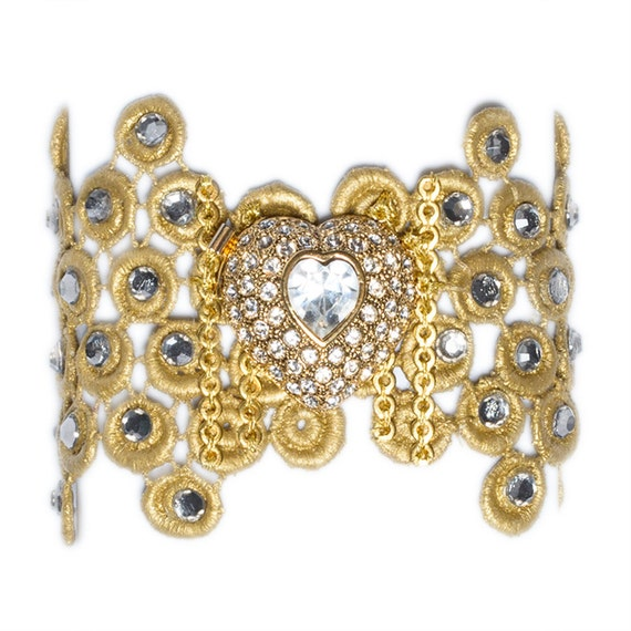 Gold lace bracelet with grey swarovsky crystals and a gorgeous silver and crystal heart brooch.