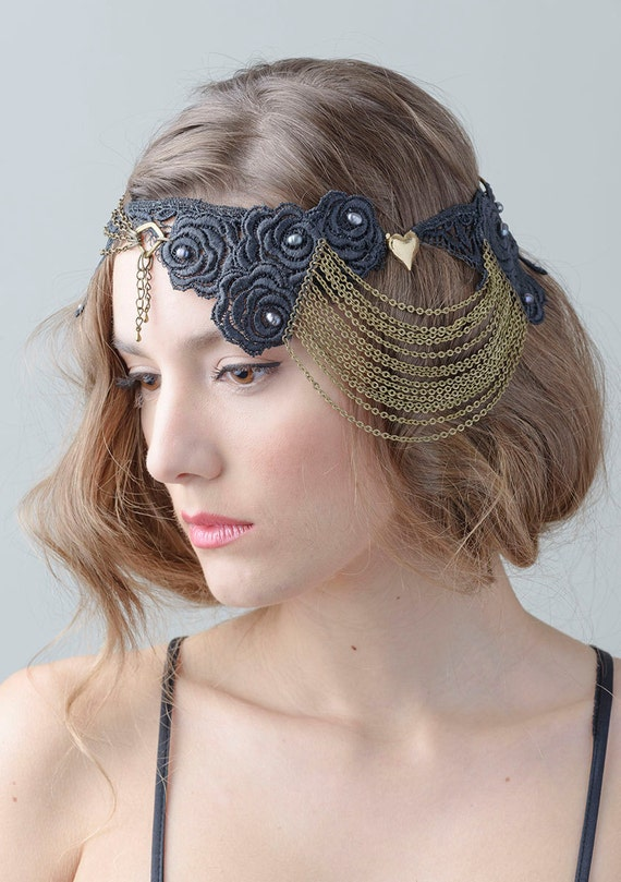 Stunning black lace headdress, gold tone chains, vintage heart brooch.