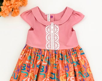 Size 5 Girls Classic Style Back To School Dress with Pink Top and Alphabet Skirt with Lace and Button, Snap Trim, First Day of School Dress