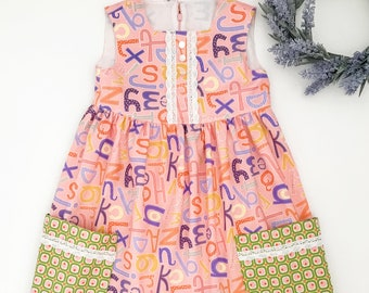 Size 6 Girls Pink Sleeveless Alphabet Back To School Dress with Decorative Lace Trim and Pockets, First Day of School Dress, School Dress