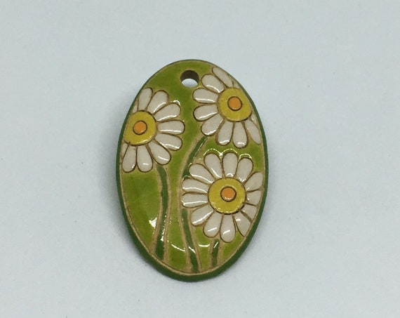 Daisy Pendant, Green Background With White Daisies, Oval Shape Measures Approximately 1.5 Inch x 3/4 Inch