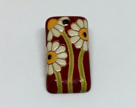 Daisy Pendant, Red Background With White Daisies, Rectangular Shape Measures Approximately 1 Inch x 1/2 Inch